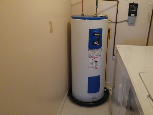 Older Electric Water Heater with Catchment Tray